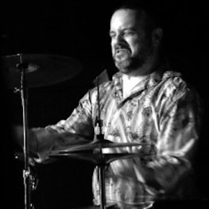 About Eliza Neals John Medeiros on drums